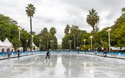 Skating rink at Christmas fair in Sevilla, Spain. SEVILLA, SPAIN - DECEMBER 15, 2017: Ice skaters having fun on skating rink at traditional Christmas fair on stock images