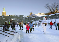 Skating rink in Quebec City, Porte Saint-Jean, Canada. People skating during the Quebec Winter Carnival together with snowman mascot Stock Photography