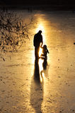 Skating, silhouette of the child. Stock Photos