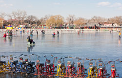 Skating tools- Bicycle on ice. Beijing, China, December 24th, 2011: Beijing Shichahai(Houhai) skating People.People hire Bicycle on ice also play royalty free stock photography