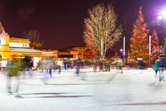 Skating in Victoria Park downtown London. December 27 2013 London Canada. long exposure creates motion blur of skaters enjoying the downtown rink in Victorria Stock Image