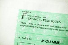 Skatter i den Frankrike checken som utfärdas av den riktningsGenerale desen Fina royaltyfria foton