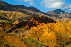 Colorful mountains, yellow and different color painted hills. Skazka fairy tale canyon in Kirgyzstan, in Kyrgyz Republic, near Issuk Kol lake. Red yellow castle Stock Photography