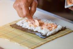 Sked som sätter sås på ris Fotografering för Bildbyråer