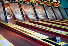Skee Ball Amusement Game. A row of midway Skeeball bowling amusement game at an arcade.  When you get the ball into the target it pays out with tickets you can Stock Photography