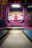 Skee ball arcade bowling game. Skee ball bowling game machine targets and lane at an amusement arcade Stock Image