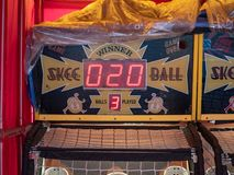 Skee ball arcade game sitting in tent outdoors with a score of 20 stock photo