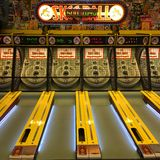 A Skee ball game sits vacant late at night Royalty Free Stock Photography