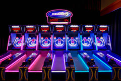 Skee ball Machines with Neon Lights. This is one of Dave & Busters arcade games Royalty Free Stock Images