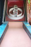Skeeball carnival arcade game. Skeeball arcade game (roll the ball so it jumps into the points, a carnival game Stock Photography