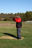Skeet Shooting. A teenage boy practicing to improve his skeet shooting score Stock Photo