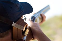 Skeet Shooting. A man in a Skeet Shooting competition Stock Image