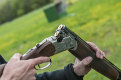 Skeet Shooting. In Denmark with grass background Royalty Free Stock Images