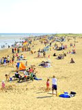 Skegness beach, Lincolnshire. Families enjoying an August day on a busy beach at Skegness, Lincolnshire, England, UK Royalty Free Stock Photography