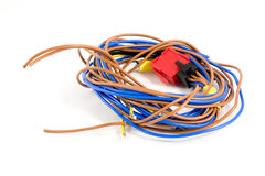 Skein of blue and brown wires on a white background. The red plu. G Stock Photos
