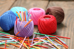 Skein of colored thread and plastic needles close-up Royalty Free Stock Image