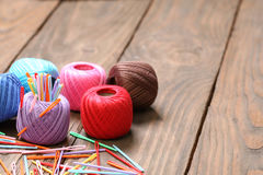 Skein of colored thread and plastic needles close-up Stock Photos