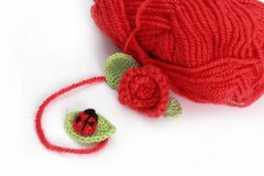 Skein and crochet ladybird on the leaf. Red rose Royalty Free Stock Photography
