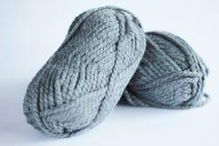 Skein of grey thread on the wight backround. Stock Photos