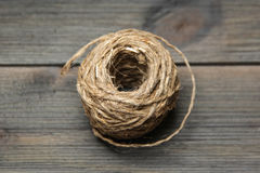 Skein of jute twine on a dark wooden background Royalty Free Stock Image