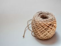 Skein of jute twine isolated on white background. With copy space. Roll of natural jute rope stock image