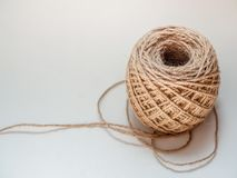 Skein of jute twine isolated on white background. With copy space. Roll of natural jute rope royalty free stock photo