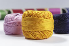 Skein of orange cotton thread in foreground Royalty Free Stock Images