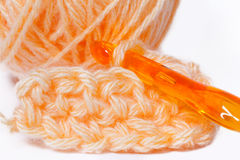Skein of orange yarn closeup and crocheting Stock Photos