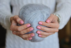 Skein of thread in female hands Stock Photos