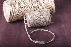Skein of twine on a brown background Royalty Free Stock Images