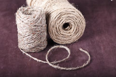 Skein of twine on a brown background Stock Images
