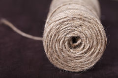 Skein of twine on a brown background Royalty Free Stock Photo