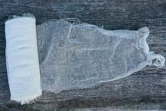 A skein of white gauze bandage on a gray table stock photo