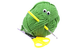 Skein of wool with eyes and scissors Royalty Free Stock Photo