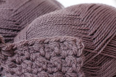 Skein of yarn mocha color and knitting Royalty Free Stock Images