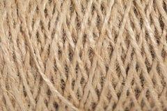 Skeinen av jute tvinnar, texturerar Arkivfoto