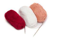 Skeins of colored yarn and spokes Stock Image