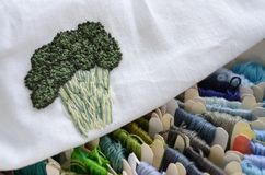 Skeins of colorful threads in cold colors for embroidery and sewing, broccoli embroidery stock photos