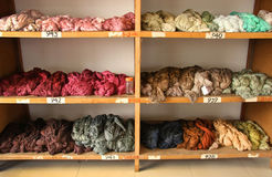 Skeins of dyed silk thread. In various colors at a silk rug factory in Shanghai, China Royalty Free Stock Image