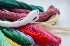 Skeins of eight colorful threads in a warm colors for embroidery and sewing stock image