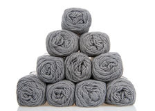 Skeins of gray yarn stacked in a pyramid isolated on white Royalty Free Stock Photo