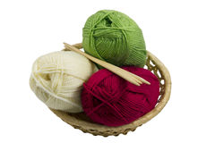 Skeins and knitting needles in basket Stock Photography