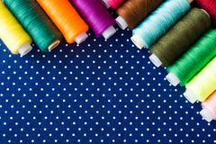 Skeins of multicolored threads for needlework as a background. Copy space for text royalty free stock images
