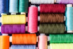 Skeins of multicolored threads for needlework. As a background stock photo
