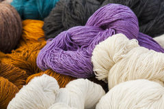 Skeins of natural wool. Stock Photos