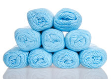 Skeins of powder blue yarn stacked partial pyramid shape isolated on white Royalty Free Stock Images