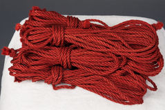 Skeins of red ropes for bondage Stock Photo