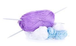 Skeins of violet, blue, white yarn and needles Royalty Free Stock Photos
