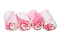 Skeins of white and pink thread. Royalty Free Stock Photos