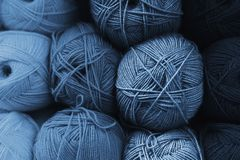Skeins of wool in all shades of classic blue. Handmade concept. The color of the year 2020 is classic blue. Gradient color.
